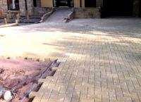 Image of front of house paved